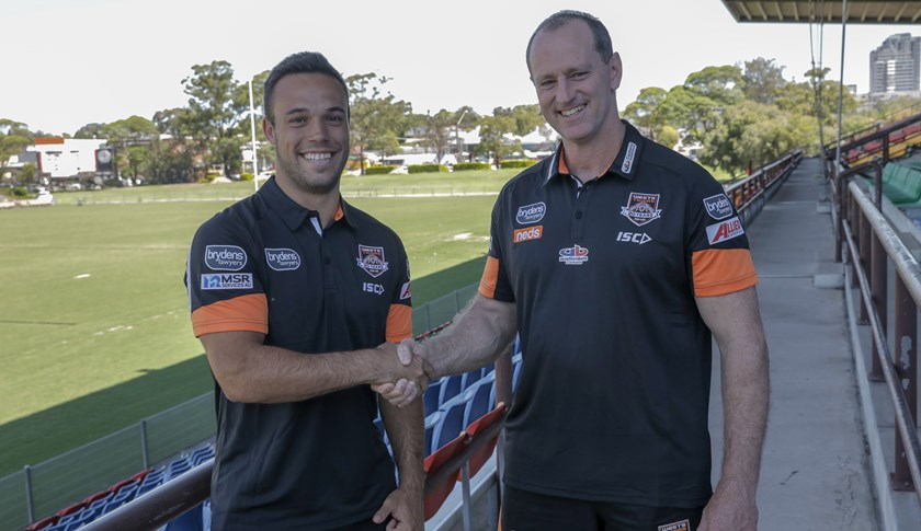 Wests Tigers halfback Luke Brooks and Head Coach Michael Maguire.