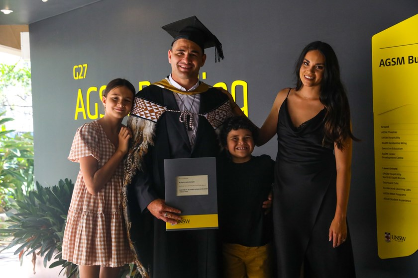 Russell Packer with his family after completing his MBA earlier this year