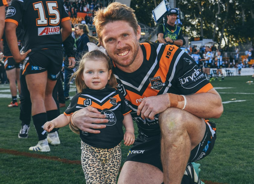 Wests Tigers forward Chris Lawrence and daughter Emmerson at Leichhardt Oval