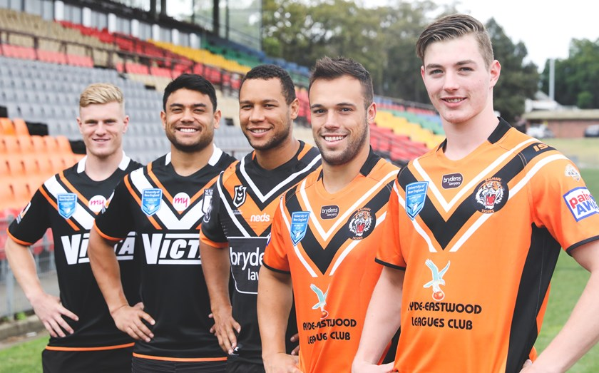Western Suburbs Magpies juniors Cameron Lawrence and David Nofoaluma, Wests Tigers captain Moses Mbye and Balmain Tigers juniors Luke Brooks and Zane Camroux.