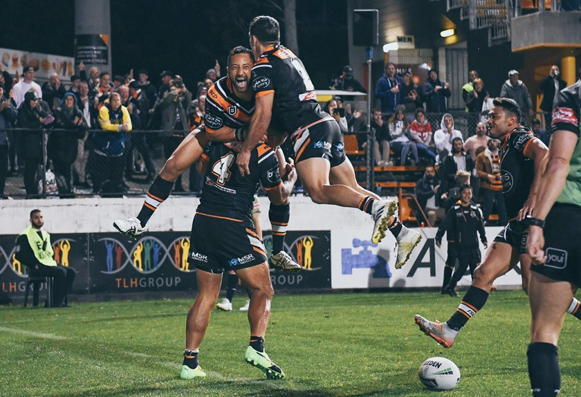 Wests Tigers celebrate a try against the North Queensland Cowboys at Leichhardt Oval