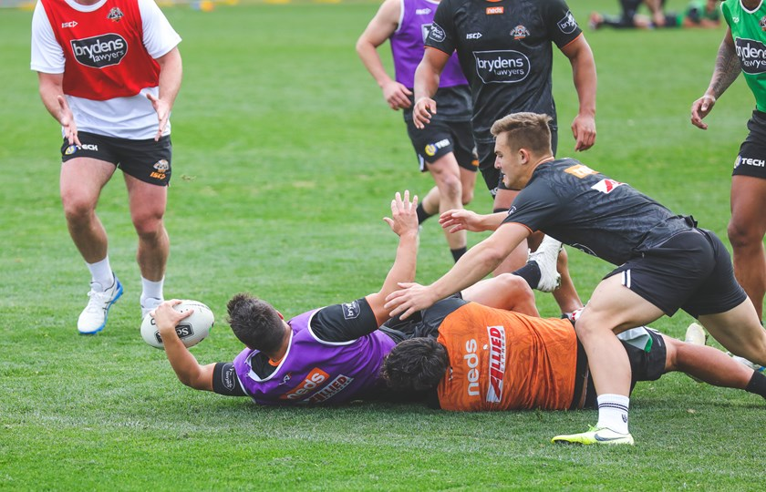 Luke Brooks takes on the line and reaches out to score at Wests Tigers training.