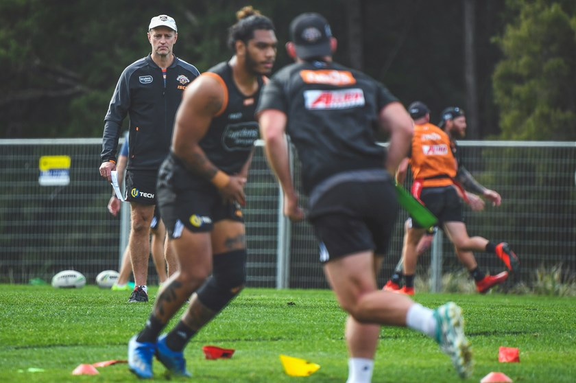 Wests Tigers Coach Michael Maguire watches on at training