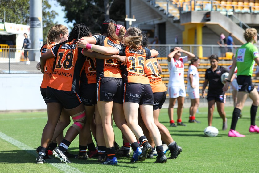 Weststigers Tarsha Gale Cup girls celebrate against the Dragons